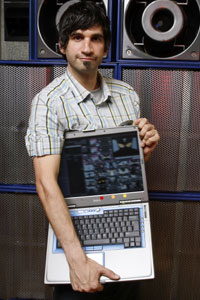 Guy Holding Laptop Full Of Resolume!