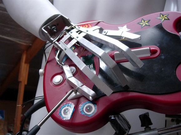 Guitar Hero playing robot