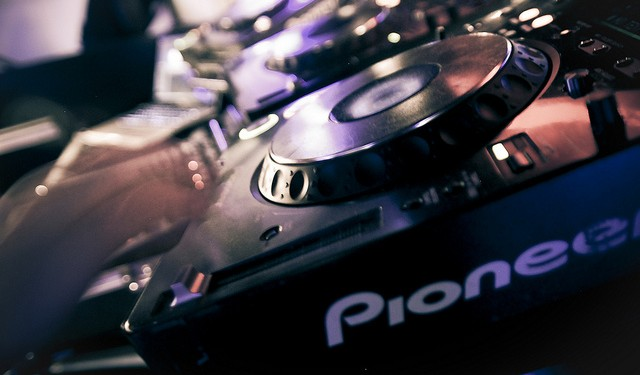 Pioneer's CDJ sometimes seems as much a part of the club scene as ... a bar. An NI software update marries the decks and their onboard UI to Traktor's mix, cueing, remix, and library features. Photo (CC-BY-ND) Will Will, in the UAE.
