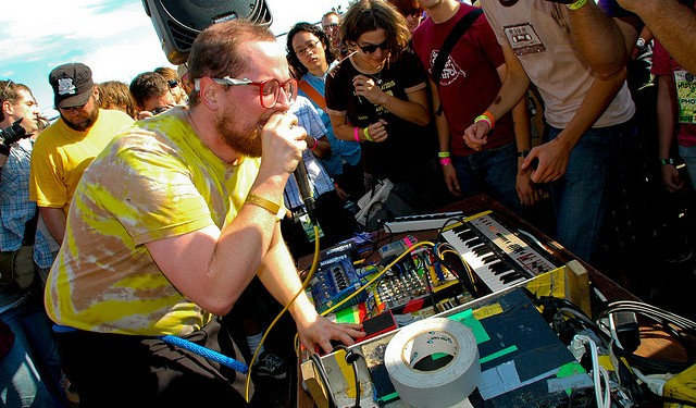 Dan Deacon, in action - and judging by that array of gear oddities, one of us. Photo (CC-BY) Joshua Rothhaas.