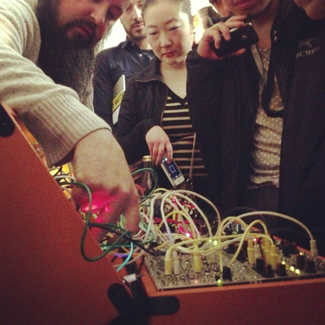 Keith shows onlookers how he makes music with wires.