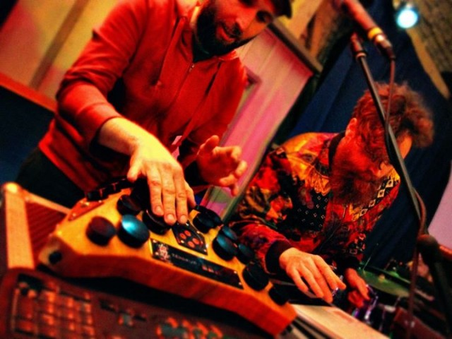 "No kit - but no sequencer. Using the <a href=""http://www.zendrum.com/"">ZenDrum</a> controller, musician Nick Froud (left) is one of a handful of growing artists using finger dexterity to trigger electronic sounds in an entirely human fashion - no machine timing needed. Photo by <a href=""http://josephshepherdphotography.wordpress.com/"">Joseph Shepherd</a>, courtesy the band."