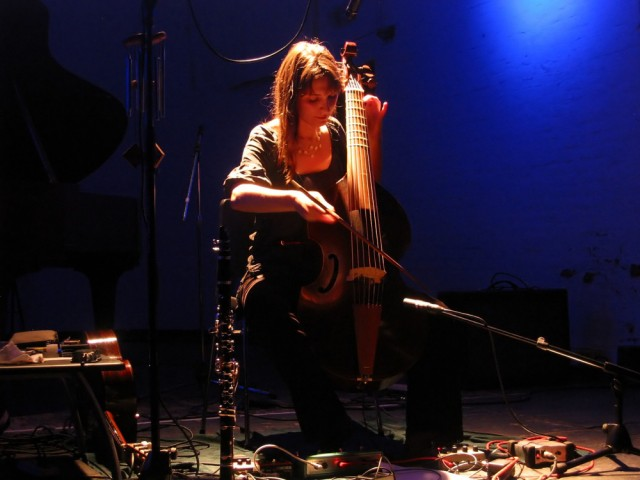 Colleen playing live in Brussels in 2007, flanked by an array of stompboxes doing the work - a modular on the floor.  Photo by Pascal Vermeulen, courtesy Colleen.