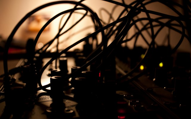 "Late at night, patching cables in Make Noise's brilliantly-named ""Maths"" module. Photo (CC-BY) x2mirko - another German artist using American modules in the homeland of Eurorack."
