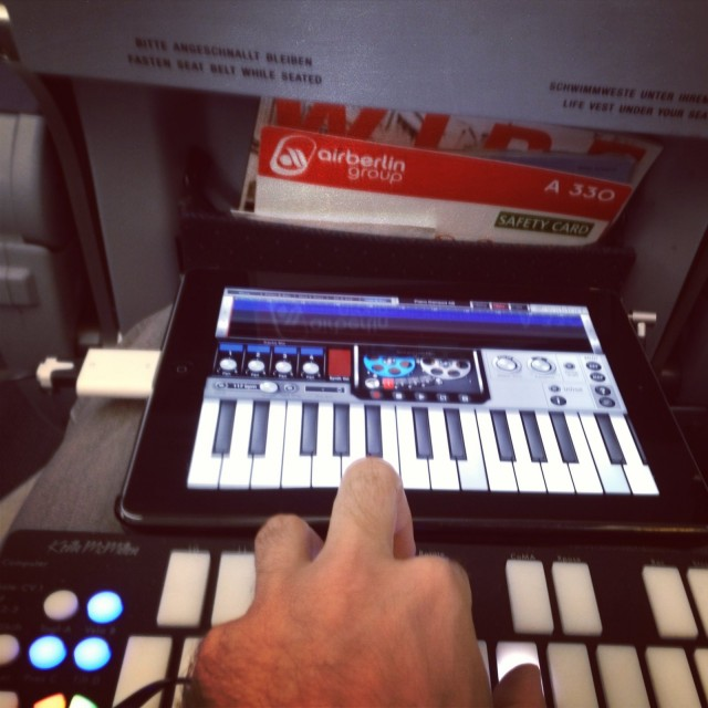 Tested at 35,000 feet: yes, it's possible to use QuNexus and iPad in coach. I managed to get some sound designs and melodic patterns together without disturbing anyone - seriously. Oh, and a nice compliment for the idea of the digital instrument: an older man seated next to me asked if I was a pianist as we deplaned.