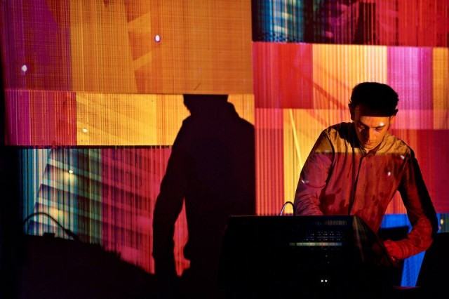 Cristian Vogel reimagined his latest album release, as promised, whilst lit by a calico-colored quilt of overlaid slide projector imagery. Photo courtesy Krake Festival.