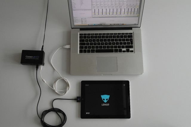 iConnectMIDI2+, connected to an iPad and MacBook.