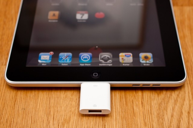 Apple's iPad Camera Connection Kit, providing a USB port, as connected to a first-gen iPad. (CC-BY) Håkan Dahlström Photography