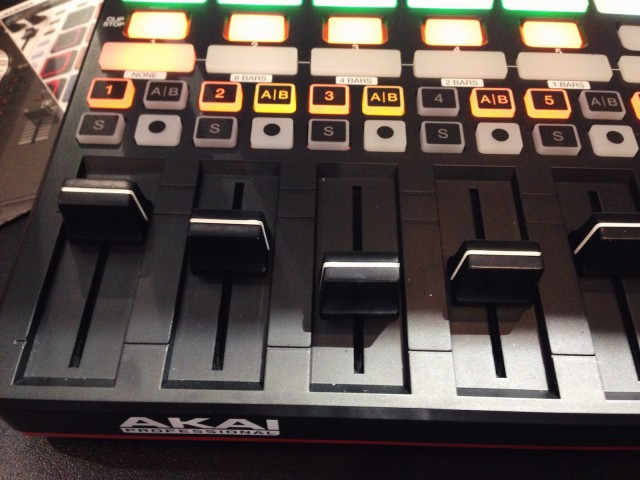 The APC40 mkII now really looks like the mixer strips in Ableton's Session View. Knobs are at the top, and can be mapped to pan or sends. And note the dedicated A and B buttons for assigning tracks quickly to the crossfader. That could make the APC40 mkII a preferred controller for live/DJ use.