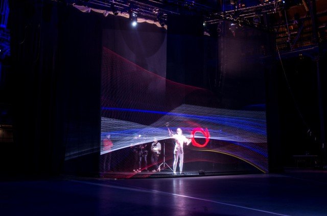 Imogen, dwarfed by the visuals. Yes, they shot this live on a stage. Photo: Adrian Lausch.