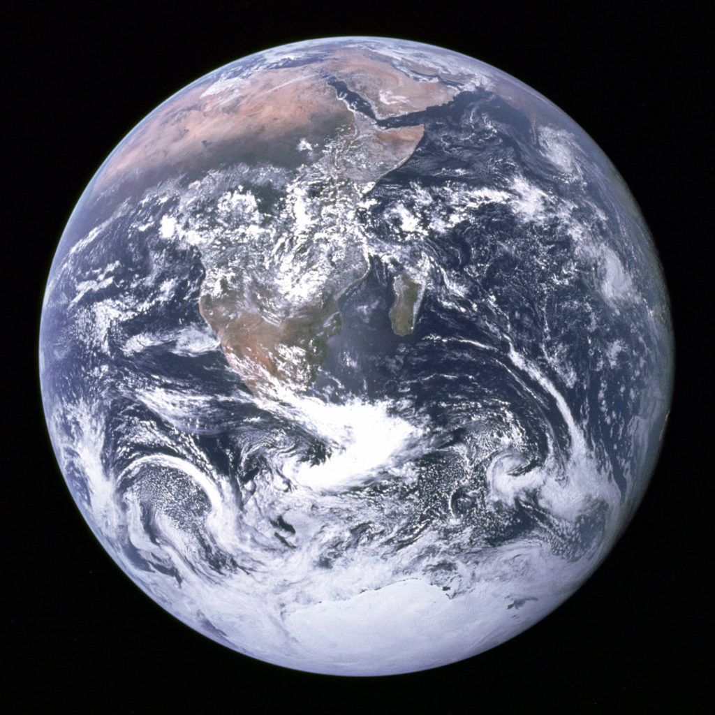 Earth as seen from Apollo 17 - an image that has become widely known partly because the NASA-produced photo is in the public domain. (And partly because it's an amazing image that humans had never seen before.)