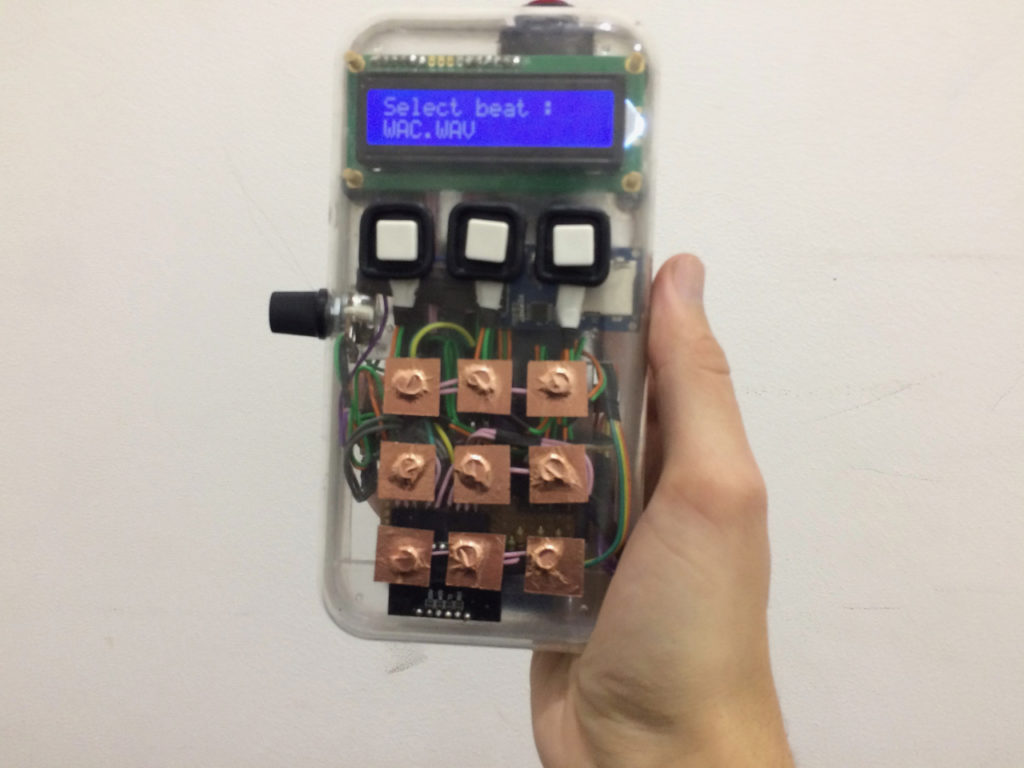 Here's a cool handheld drum machine you can build with