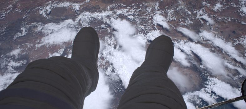 Thomas Pesquet snapped this photo looking over his feet at our planet. Photo source ESA/NASA.